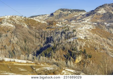 Winter Alpine Scenery With Small Romanian Village In The Valley Of Piatra Craiului Mountains, Brasov