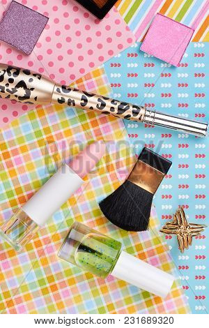 Makeup Products On Patterned Background. Cosmetics And Jewerly. Female Makeup Essentials.