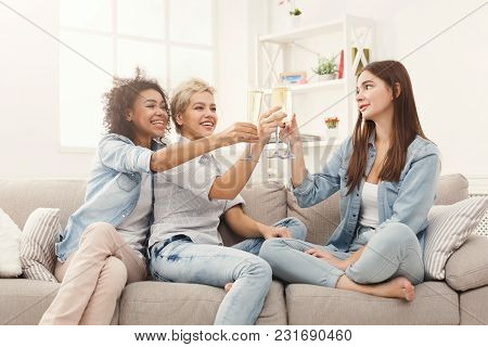 Three Friends Toasting With Champagne Glasses. Young Happy Women Cheering With Sparkling Wine, Chatt