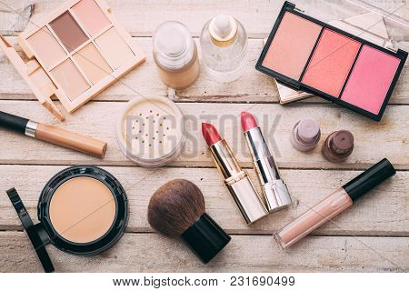 Set Of Decorative Cosmetic. Face Powder, Concealer, Eye Shadow, Blush, Foundation. Wooden Background