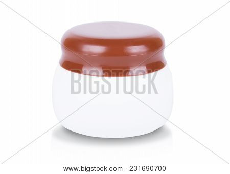 A Cosmetic Cream Jar With Brown Cap Isolated On White Background