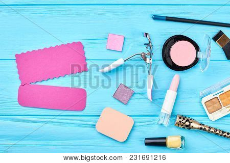 Colorful Cosmetics Set On Blue Background. Decorative Cosmetics Essentials And Tools For Make Up. Pi