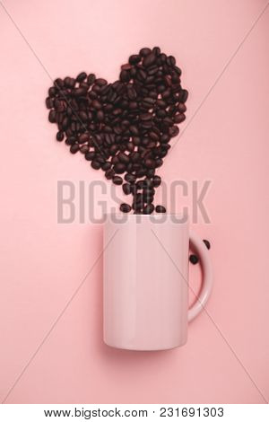 Pink Mug And Coffee Beans On Pink Background