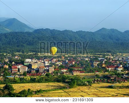 Hot Air Balloon Flying Above Vang Vieng Town, Vientiane Province, Laos. Vang Vieng Is A Popular Dest
