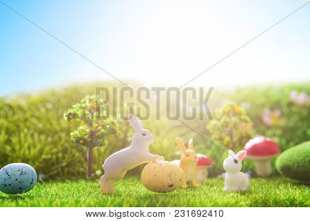 Easter Rabbits Toy On Spring Green Grass. Fairy Tale.