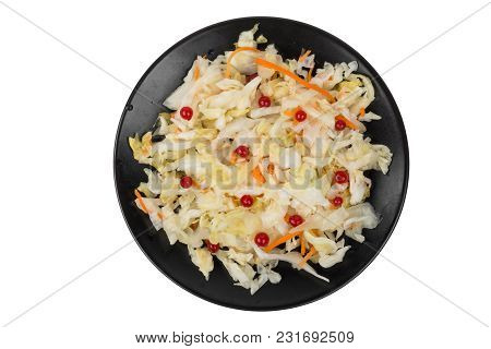 Salad Sauerkraut With Cranberries In Black Plate Isolated On White Background. Top View
