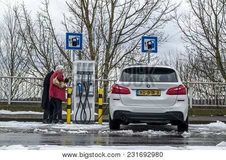 Limburg , Germany - February 11 2018 : Couple Using The E-filling Station.
