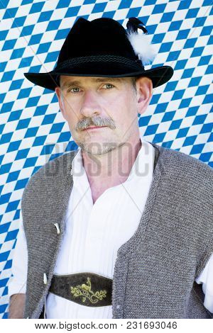 Portrait Of Handsome Bavarian Man On Blue And White Background