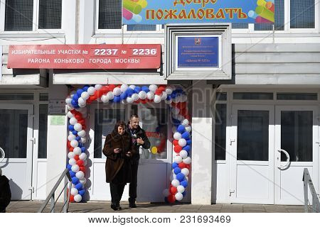 Moscow, Russia - March 18, 2018: The President Election In Russia. People Leave The Polling Station