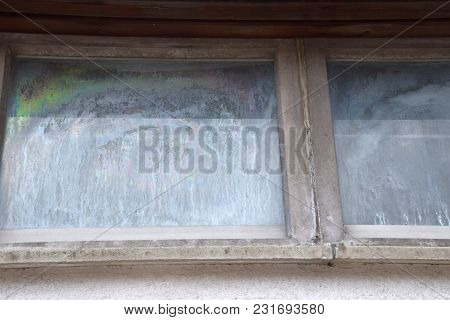 Tarnished Glass Of An Old Window, Dull And Dirty