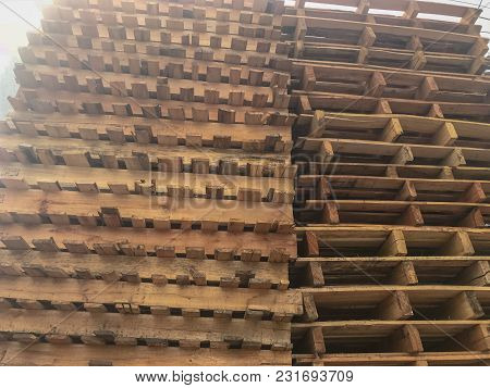 Close Up Wooden Pallets Stacked In A Warehouse