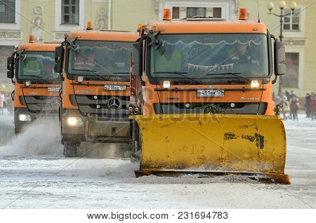 Saint-petersburg.russia.march.18.2018.night In The City The Snow Fell.his Cleaning Went Snow-removal