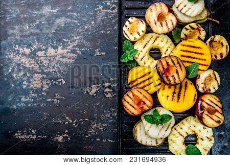 Grilled Fruits. Grill Fruits - Pineapple, Peaches, Plums, Avocado, Pear On Black Cast Iron Grill Boa