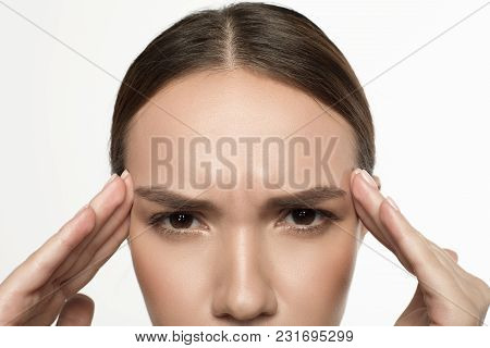 Splitting Headache. Half Of Face Of Young Exhausted Female Is Touching His Head. She Is Looking At C