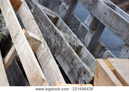 Old Rotted Pallets Stand Next To New Pallets That Have Foxing