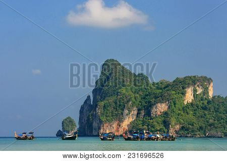 Ao Loh Dalum Bay With Anchored Longtail Boats On Phi Phi Don Island, Krabi Province, Thailand. Koh P