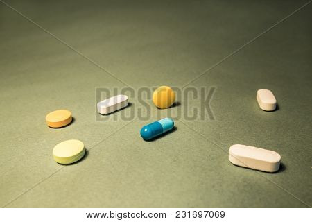 Multicolored Pills And Medications On A Panoramic Photo Close Up. Can Be Used In Publications On The