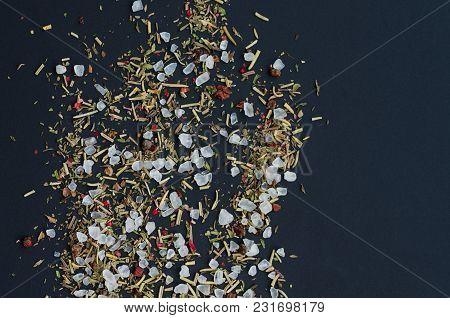 Coarse Grinding Of Sea Salt. Ground Spices And Herbs. Dark Background.