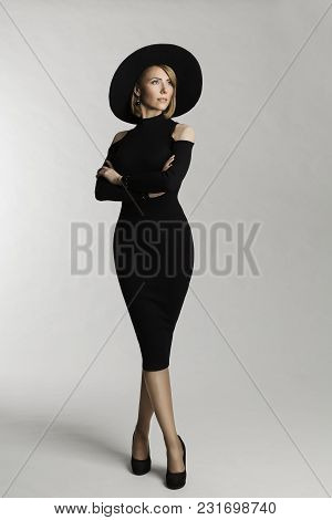 Fashion Model Long Dress, Hat Wide Brimmed, Elegant Woman Beauty Portrait, Lady Posing On White Stud