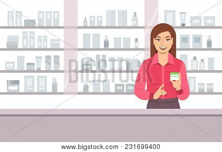 Young Woman Seller Offering Face Cream At The Counter Of A Beauty Shop Opposite Shelves With Skin Ca