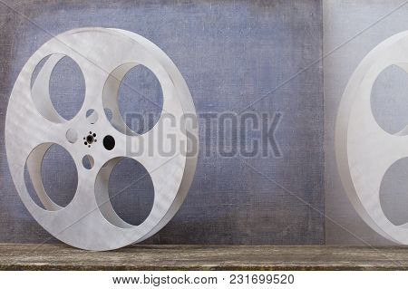 Old Motion Picture Film Reel On Colour Background