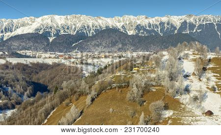 Winter Alpine Scenery With Small Romanian Villages In The Valley Of Piatra Craiului Mountains, Rucar