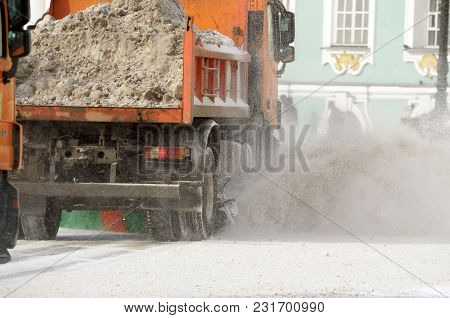 Night In The City The Snow Fell.his Cleaning Went Snow-removal Vehicles.they Cleared The Roads On Th