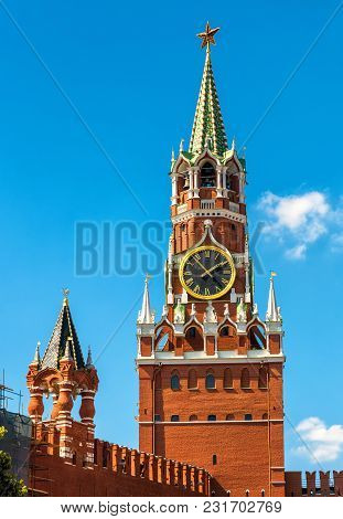 The Famous Spasskaya Tower Of Moscow Kremlin In Summer, Russia. Spasskaya Tower On The Blue Sky Back