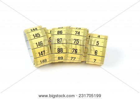 Yellow sewing measuring tape on white background