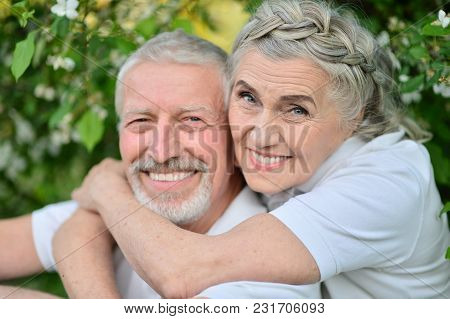 Portrait Of Happy Couple Hugging In Spring Park