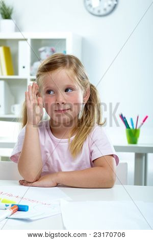 Portrait of lovely girl raising her hand at lesson