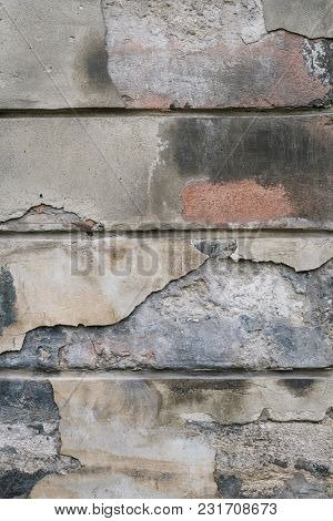 Abstract wall texture of an old house. Shabby background for design in brown tones