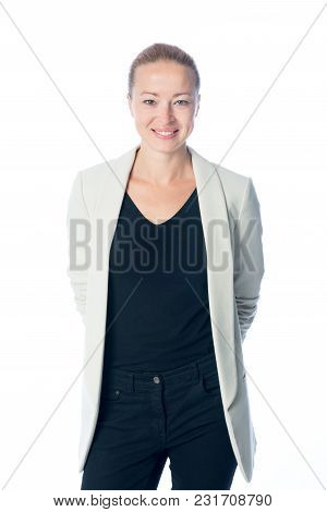 Portrait Of Casualy Dressed, Cheerful, Beautiful, Smart, Young Businesswoman In Standing Against Whi