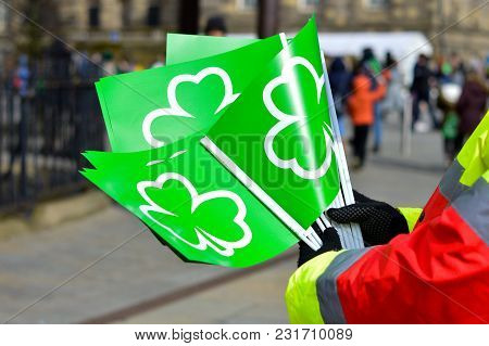 Man Holding Green Flags With Shamrock Symbol For St Patricks Day Celebration, March 17, 2018, Belfas
