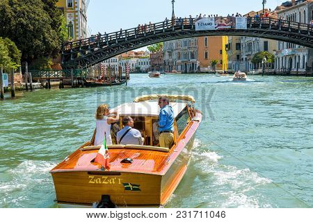 Venice, Italy - May 18, 2017: Water Taxi With Tourists Sails Along The Grand Canal In Venice. Motor