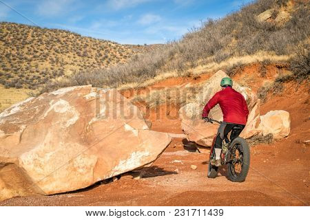 riding a fat bike on mountain desert trail in Red Mountain Open Space in northern Colorado, late fall scenery