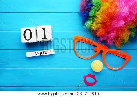 Calendar Cubes With Wig And Glasses On Blue Wooden Table