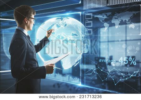 Young Businessman In Modern Interior Using Global Business Interface. Future And Innovation Concept.
