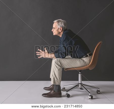 Full Length Side View Pensive Old Businessman Locating On Seat. Dreaminess Concept