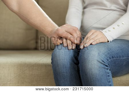 Husband Holding Hand Of His Wife, Giving Emotional Support. Mental Benefits Of Marriage. Conversatio