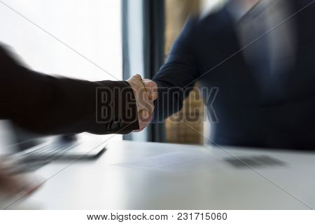 Handshake Of Business Partners After Agreement. Successful Contract