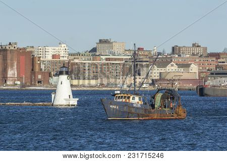 New Bedford, Massachusetts, Usa - March 18, 2018: Trawler Ruthie B. Passing Palmer Island Light Stat