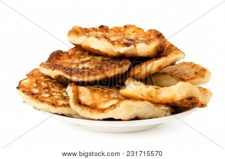 Bunch Of Homemade Pancakes In A Plate On White Background, Closeup.