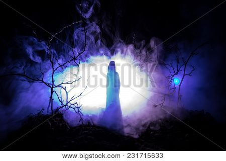 Alone Girl With The Light In The Forest At Night, Or Blue Toned Night Forest At The Fog Time. Select