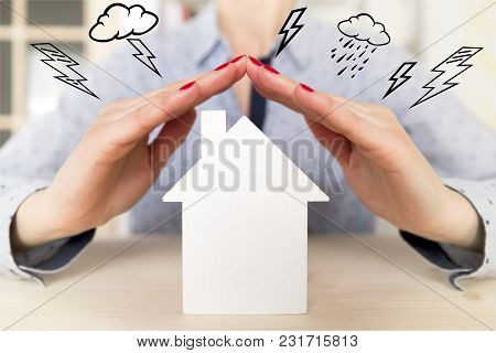 Woman Holding Her Hands Above White Small Model House As A Sign Of Home Protection And Insurance