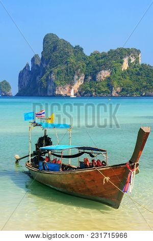 Longtail Boat Anchored At Ao Loh Dalum Beach On Phi Phi Don Island, Krabi Province, Thailand. Koh Ph