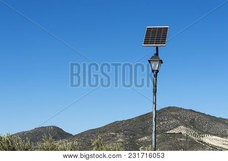 Lamp Post With Photovoltaic Solar Panel, In A Rustic Area