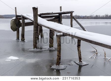 Handmade Wooden Pier On The River Bank.