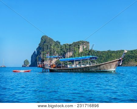 Longtail Boat Anchored Near Phi Phi Don Island, Krabi Province, Thailand. Koh Phi Phi Don Is Part Of