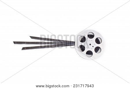 Old 8mm Cine Film And Reel On White Background